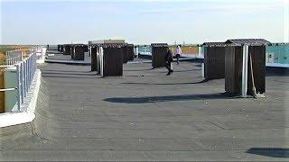 Крыши многоэтажек в Покачах покрыли новыми коврами