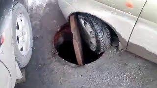 Машина провалилась в люк