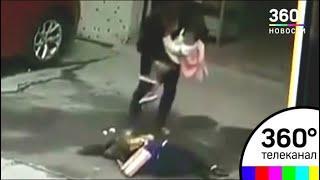 В Китае собака упала на голову женщине