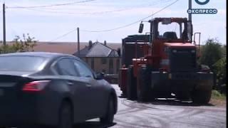 Белозерцев осмотрел отремонтированные дороги в Богословке