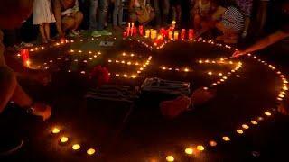 Свечи в память о погибших при пожарах в Греции