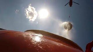 В Швейцарии вертолёты доставляют воду альпийским коровам…