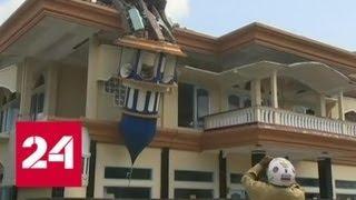 Землетрясение в Индонезии: погибших 98, раненых 200 - Россия 24