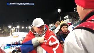 Спортсменка из Уфы развернула на трибунах в Пхенчхане красное знамя Победы