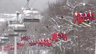 Санта-Клаусы на лыжах и сноубордах
