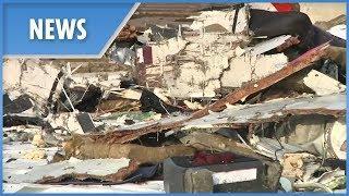 Indonesia plane crash: belongings and wreckage returned to port